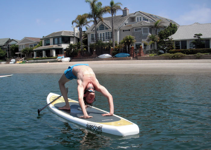 "<strong>10:45 AM: HUNTINGTON BEACH, CALIFORNIA</strong> Alexander Smith: ""Morning yoga on a stand up paddle board. I find bal"