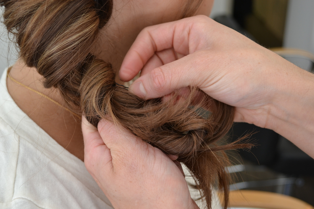 Before securing with hair tie, put bobby pins up throughout like a skeleton for the twist and then secure with hair tie. The