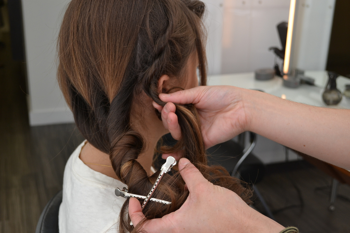 Combine the front side and back twists into one large twist. Secure with 5-6 bobby pins behind ear.