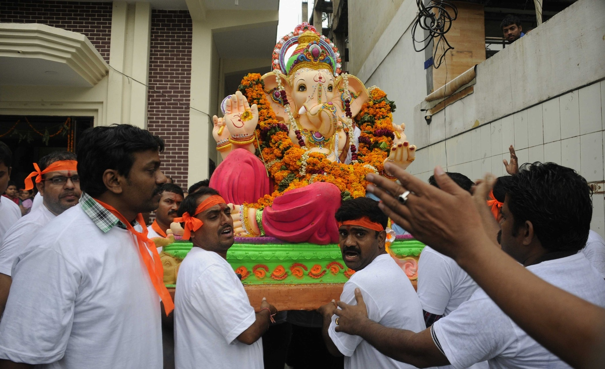 GURGAON, INDIA - AUGUST 31: Huge Idols of Lord Ganesha being taken by devouts on the occasion of Ganesha Chathurthi festival