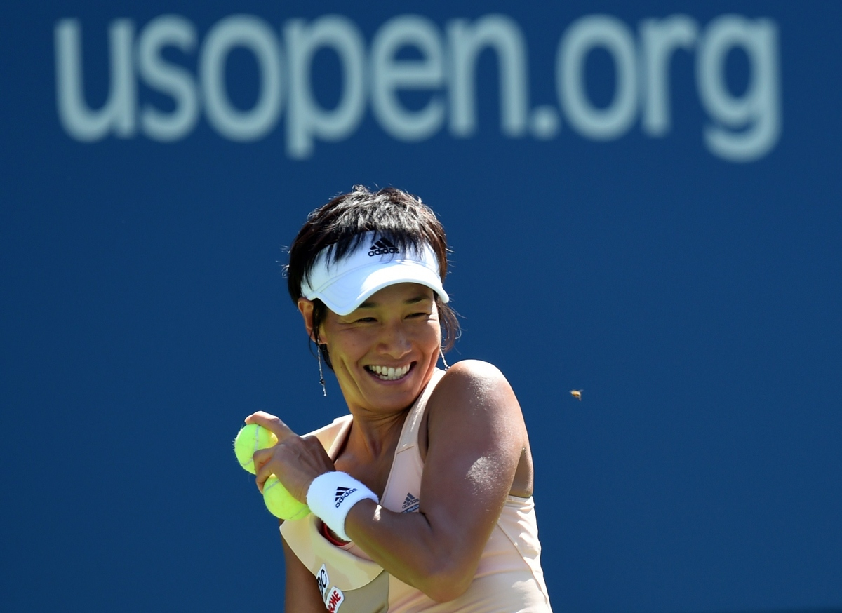 Kimiko Date-Krumm of Japan has to stop play due to a bee during her match against Venus Williams of the US during their US Op