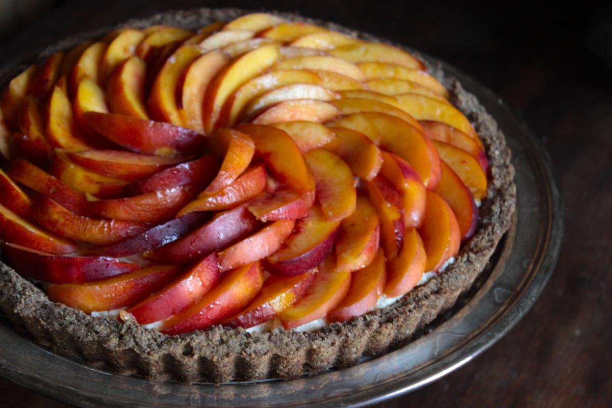 "<strong>Get the <a href=""http://bigsislittledish.wordpress.com/2013/08/15/fresh-nectarine-tart-with-a-hazelnut-crust-and-rose"