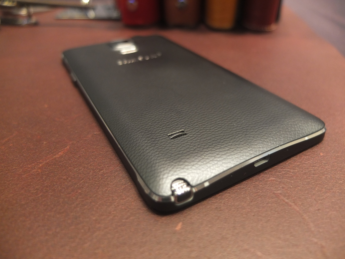 It also features a metal frame and the same 'soft touch' leather-style back plate as the Note 3.