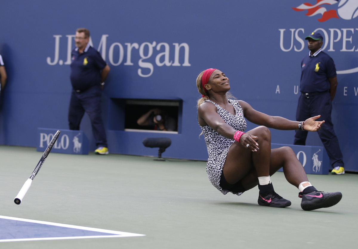 Serena Williams, reacts after defeating Caroline Wozniacki, of Denmark, during the championship match of the 2014 U.S. Open t