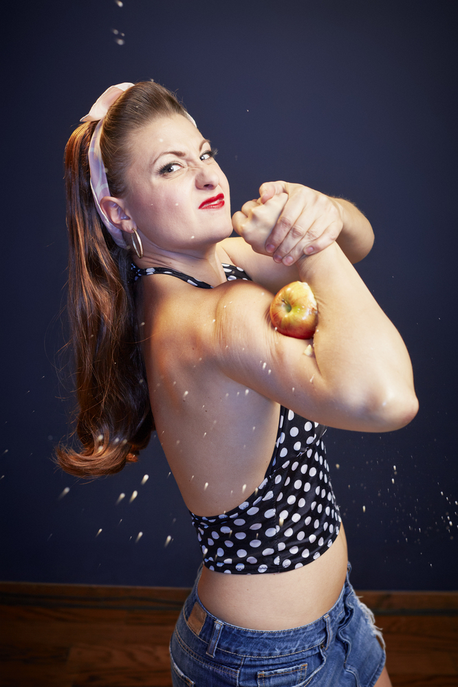 Linsey Lindberg aka Mama Lou set a world record by crushing eight apples with her bicep. Once an accountant, she now blows up