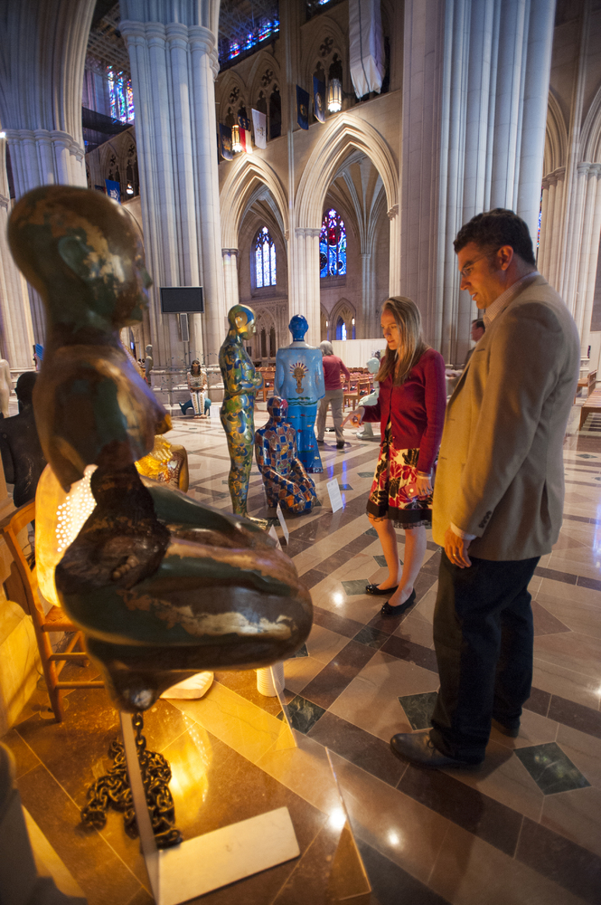 Visitors view sculptures in the Washington National Cathedral's 'Amen' exhibit