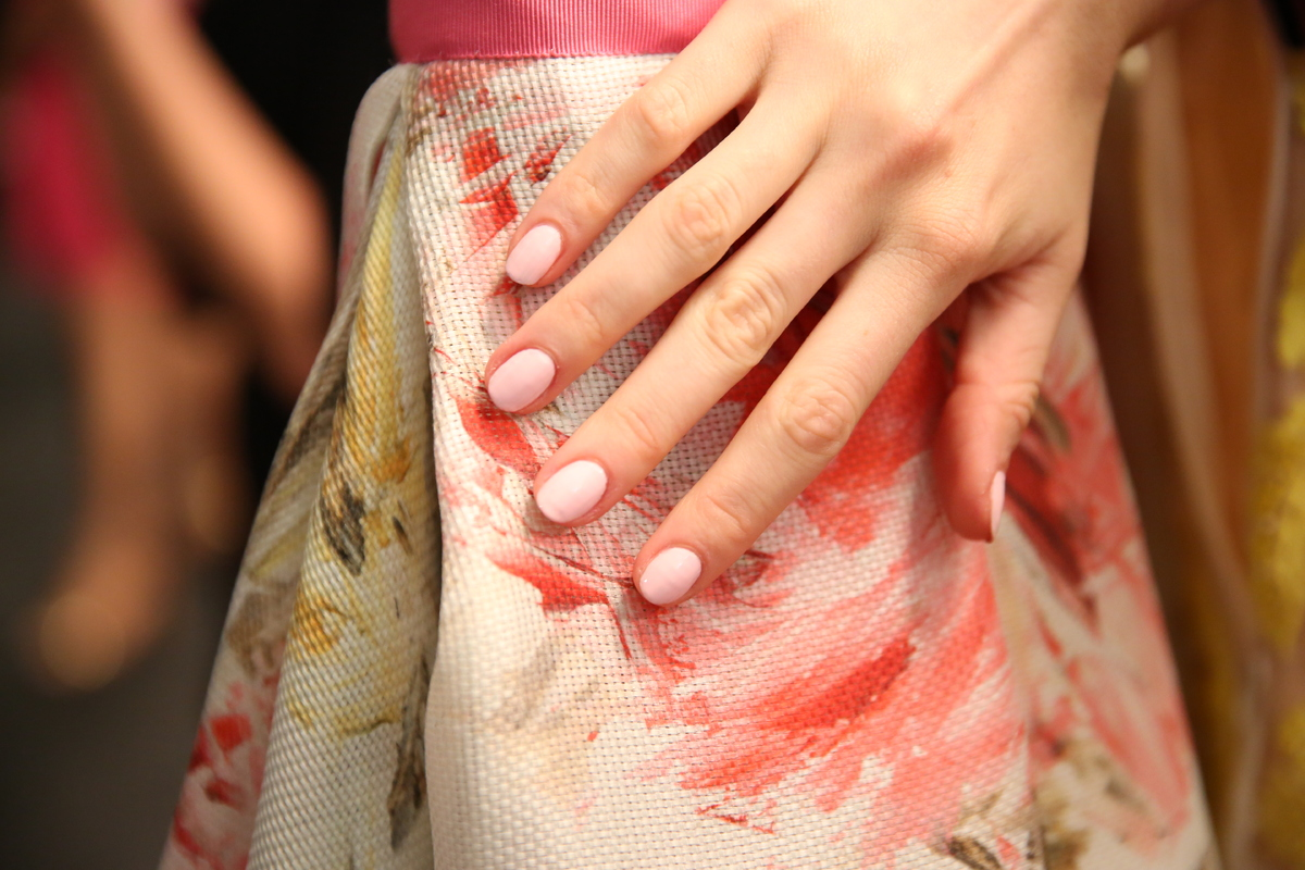 """Manicurist Julie Kandalec for Essie painted models nails in a creamy pale pink shade to embody the """"elegant and done up, but"""