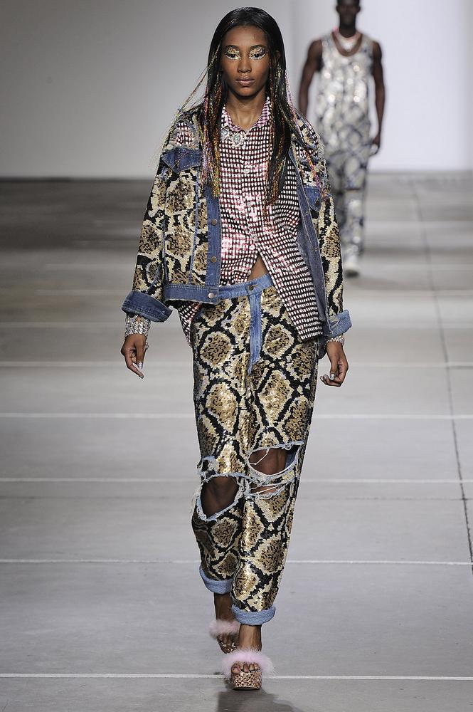 LONDON, ENGLAND - SEPTEMBER 16:  A model walks the runway at the Ashish Spring Summer 2015 fashion show during London Fashion