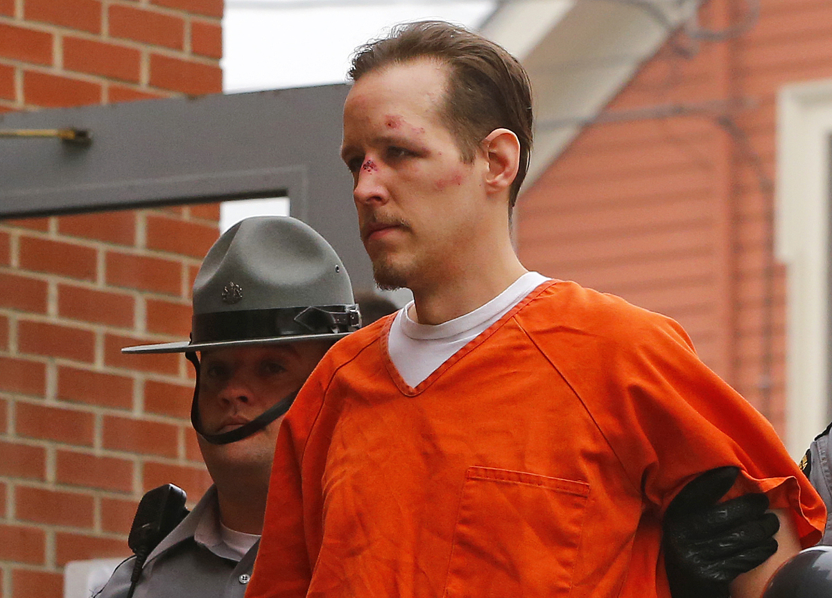 Eric Frein is escorted by police into the Pike County Courthouse for his arraignment in Milford, Pa., Friday Oct. 31, 2014. F