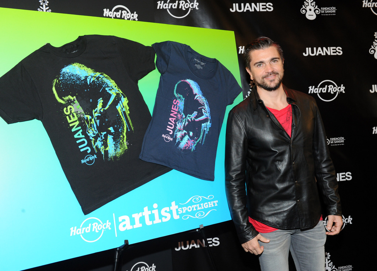 Latin rock star Juanes unveils Hard Rock's new Artist Spotlight T-shirt during a press conference at Hard Rock Cafe in New Yo