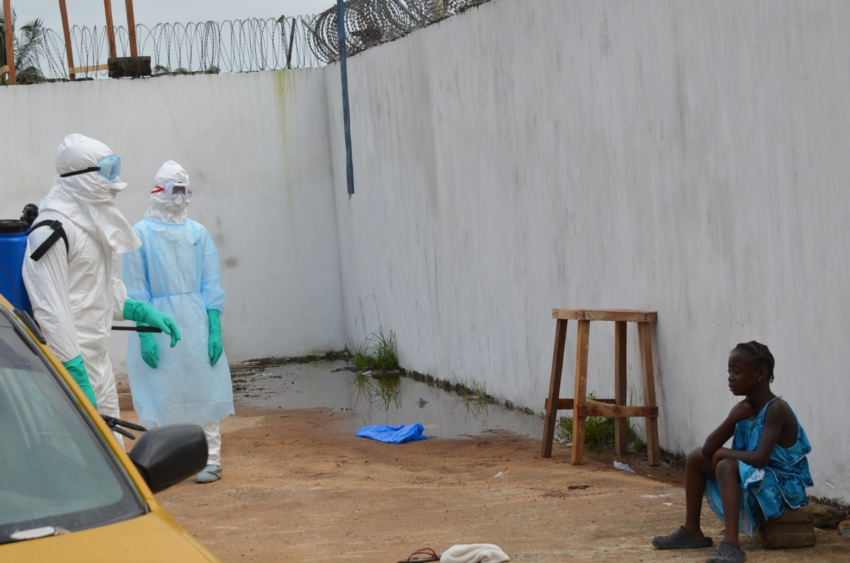 A girl cries outside  the 'Island Clinic', a new Ebola treatment centre that opened in Monrovia after the death of her father