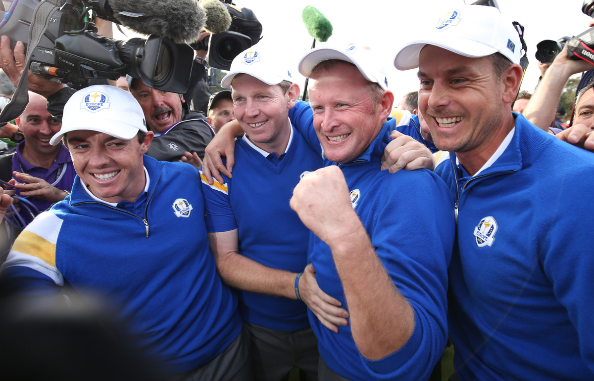 From left, Europe's Rory McIlroy, Stephen Gallacher, Jamie Donaldson and Henrik Stenson  celebrate winning the 2014 Ryder C