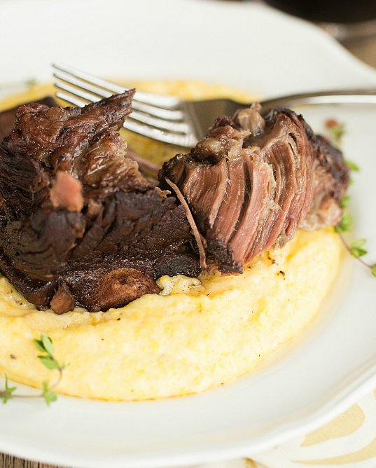 """<strong>Get the <a href=""""http://www.browneyedbaker.com/braised-short-ribs-with-cheesy-grits-slow-cooker/"""" target=""""_blank"""">Bra"""