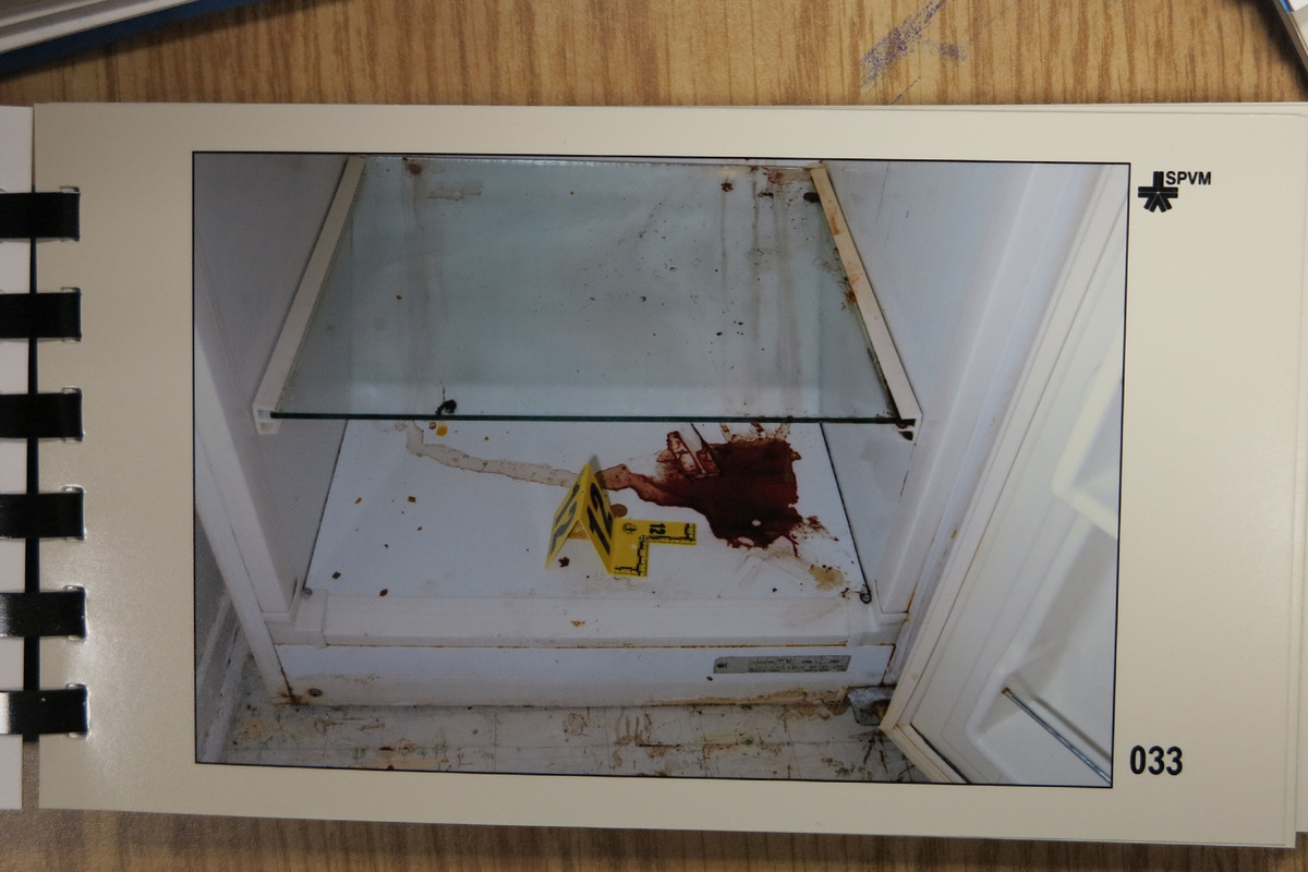 A blood soaked refrigerator found at the crime scene that at some point may have contained dismembered human remains.