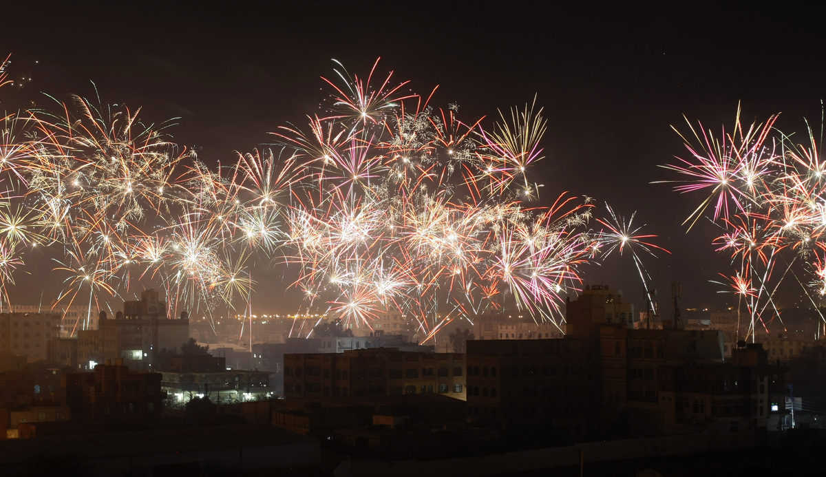 Houthi Shiite rebels release fireworks as they celebrate Sunday's signing of a U.N.-brokered deal that gave them unprecedente