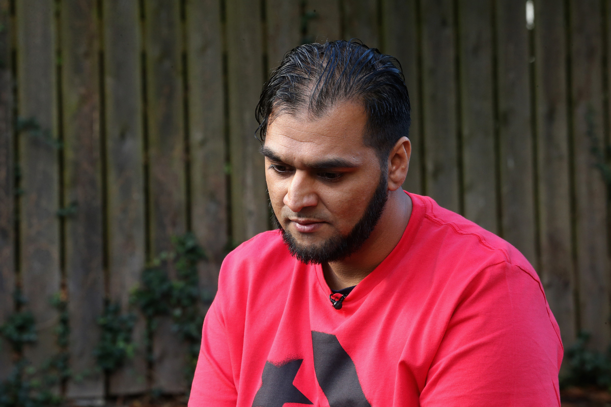 BOLTON, ENGLAND - OCTOBER 04:  Kasim Jameel, aid convoy organiser and friend of murdered British aid worker Alan Henning, tal