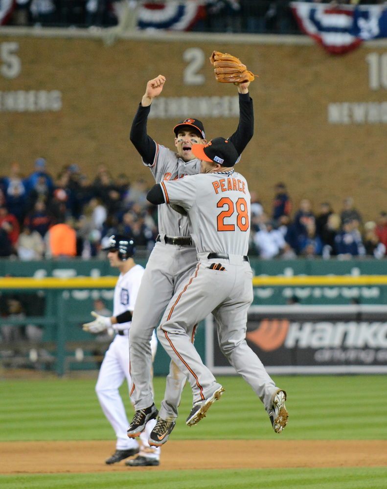 DETROIT, MI - OCTOBER 05:   Steve Pearce #28 and Ryan Flaherty #3 of the Baltimore Orioles celebrate their 2 to 1 win over th