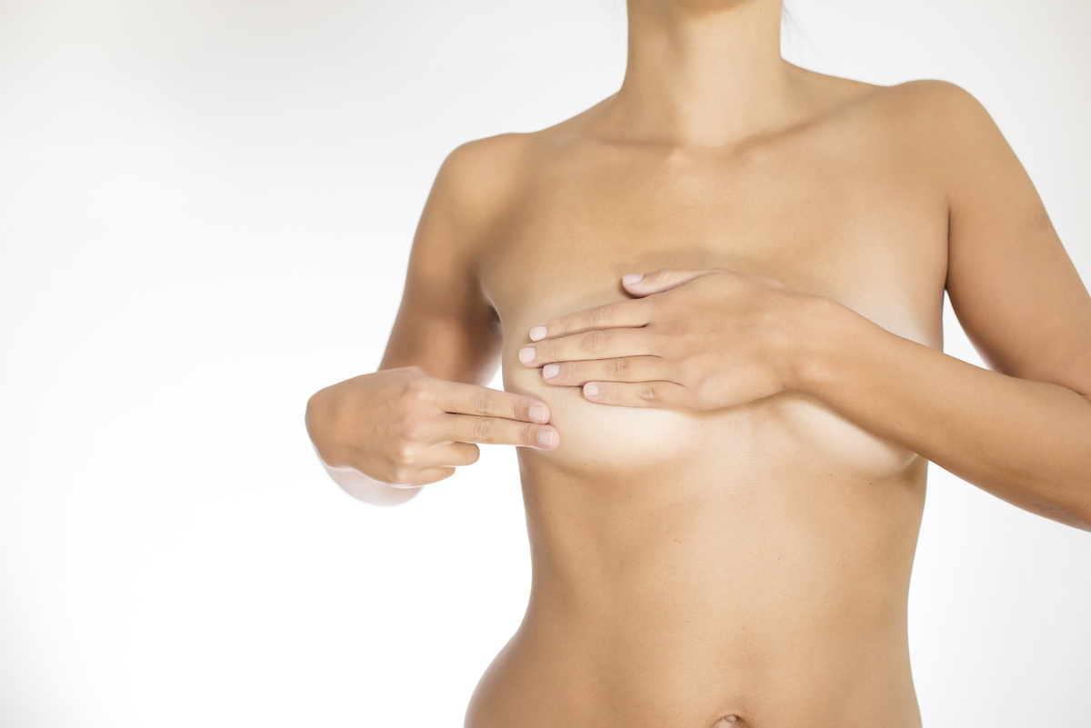 """""""A new painless, firm breast lump with irregular margins is a potential symptom of breast cancer,"""" says Dr. Sandhya Pruthi, a"""