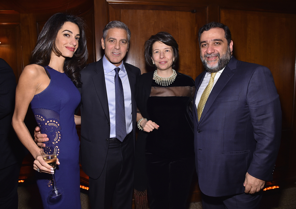 NEW YORK, NY - MARCH 10: (L-R) Amal Clooney, George Clooney, guest and Ruben Vardanian attend the 100 LIVES initiative, to ex