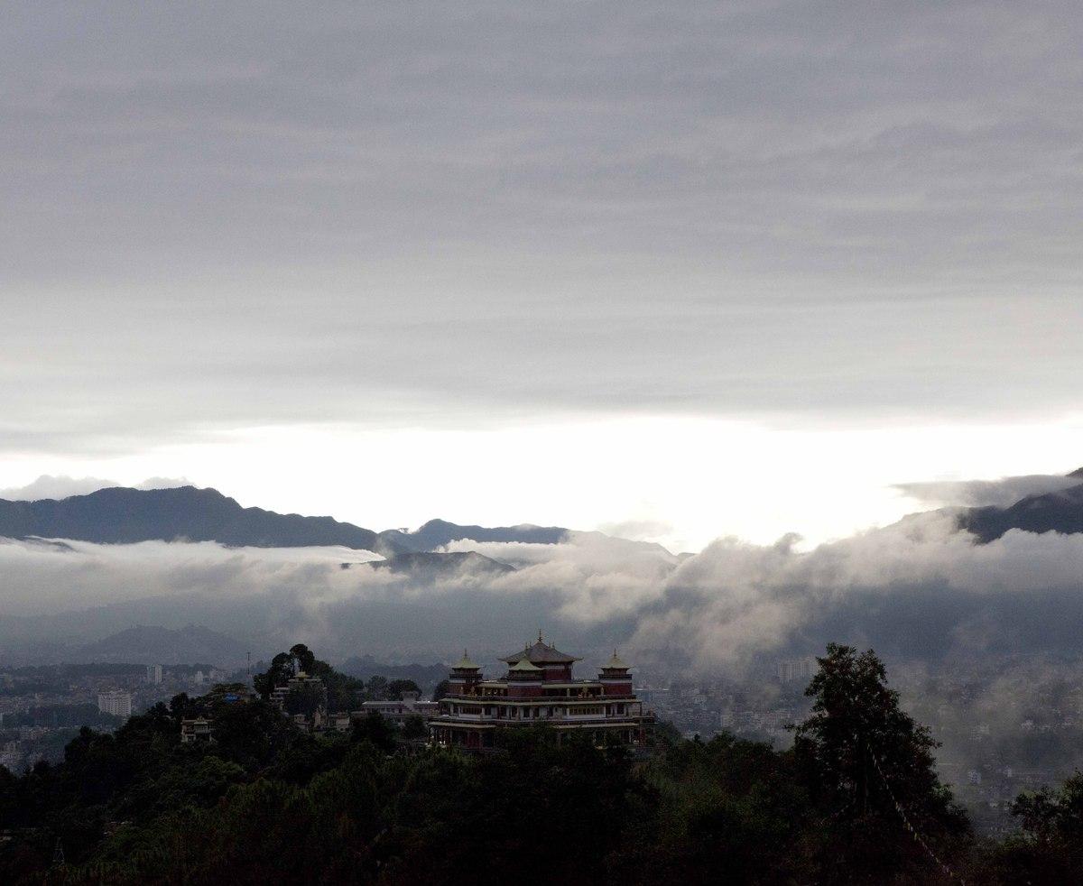 Birds-eye view of a neighboring temple taken from Pullahari Monastery, Kathmandu, Nepal.