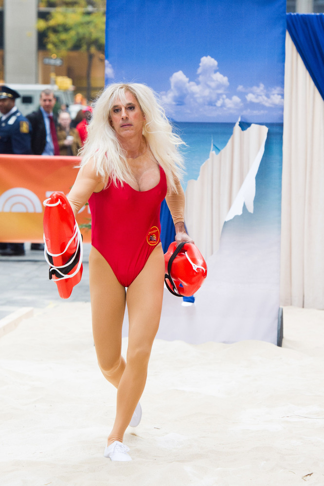 "Matt Lauer dresses as Pam Anderson's character from ""Baywatch"" on NBC's ""Today"" Halloween show on Thursday, Oct. 31, 2013 in"