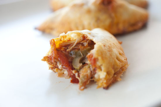 """<strong>Get the <a href=""""http://www.macheesmo.com/2013/01/pulled-chicken-empanadas/"""">Pulled Chicken Empanadas recipe</a> from"""