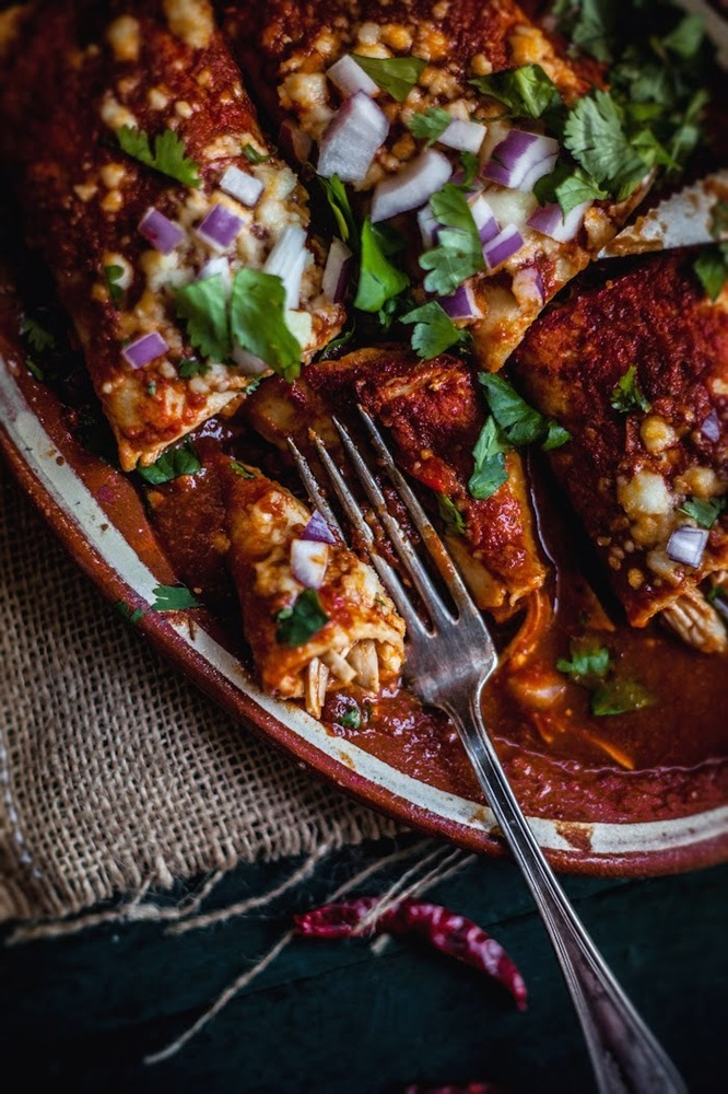 """<strong>Get the <a href=""""http://www.adventures-in-cooking.com/2014/01/chicken-enchiladas-with-three-peppers.html"""" target=""""_bl"""