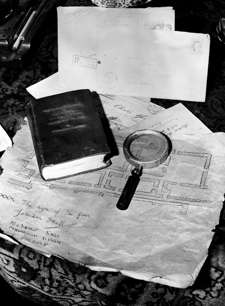 The Relics Of The Famous Detective Sherlock Holmes, Invented By Arthur Conan Doyle, In 1962. A Magnifying Glass, A Map, Lette