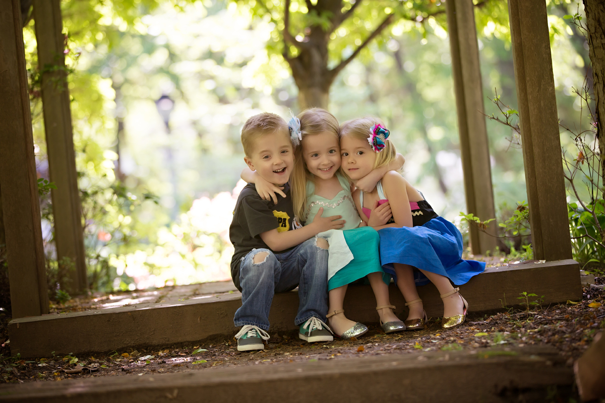 Four-year-old Eli Waller with his sisters.