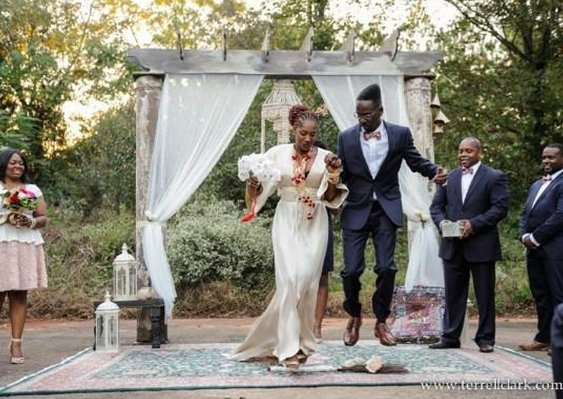 """""""Fahamu and Jamila jumping the broom during their ceremony in Atlanta, Georgia on Saturday!"""" - My Simply Perfect"""