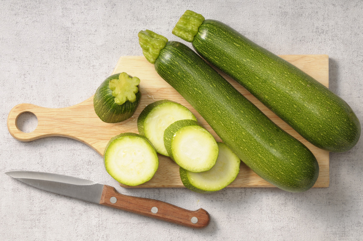 Courgette comes from the French word for the vegetable. It's the diminutive of courge, which refers to a gourde. And zucchini