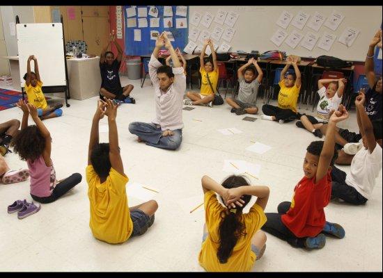 Niki A. Shah teaches Yoga to a group of kids in Passaic, NJ on July 27, 2011. ( Myra Iqbal, AOL )