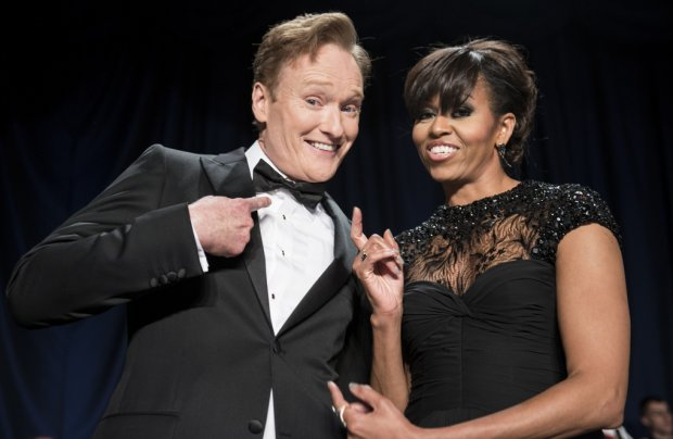 First Lady Michelle Obama and comedian Conan O'Brien pose for a photo during the White House Correspondents' Association Dinn