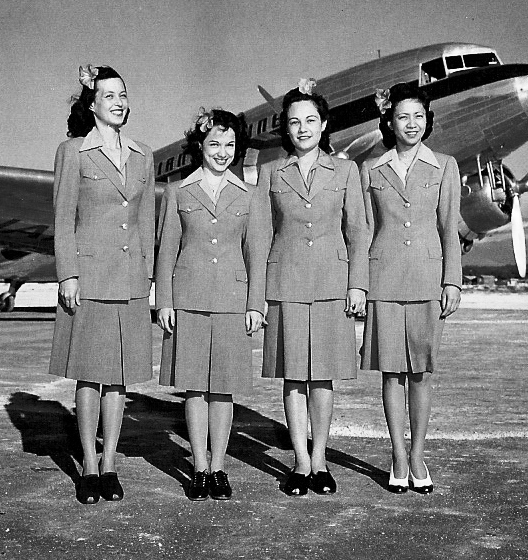 The airline hired its first hostesses to work on their 24-seat DC-3 aircraft. The uniform had  a gray jacket and matching ski