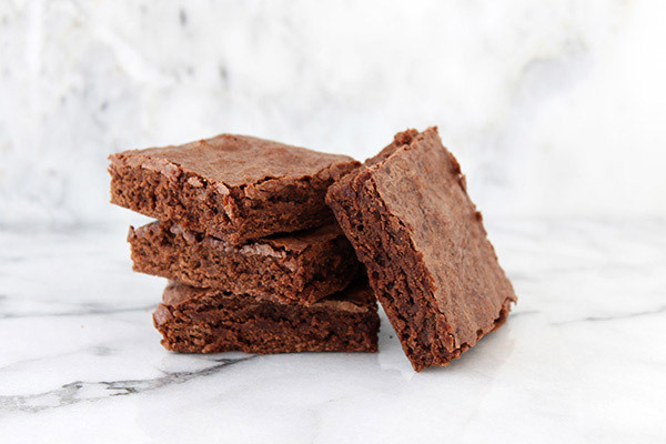 She substituted 1/2 cup of all purpose for cake flour.  The results, as Tessa reports: The brownies were lighter and softer,