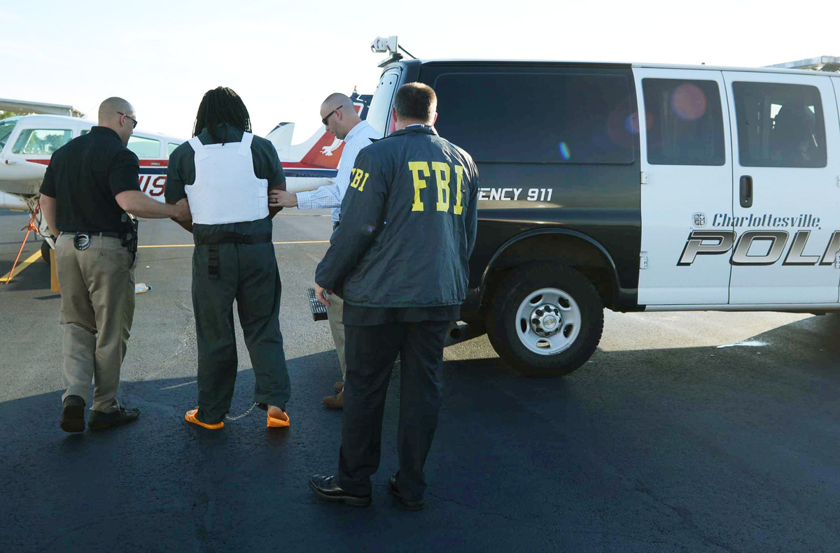 In this Friday, Sept. 26, 2014 photo provided by the FBI, officials escort Jesse Leroy Matthew, Jr., second left, during extr