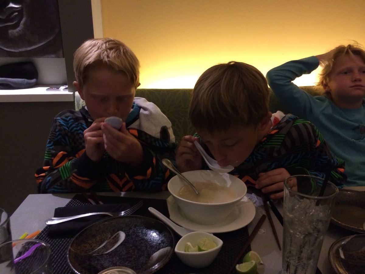 """My boys and J's son having dinner."""