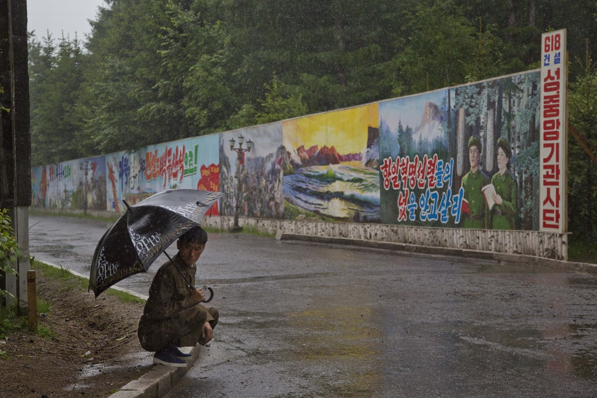 Photos From An Epic Road Trip Through North Korea HuffPost - Beautiful street murals appear on roads only when it rains