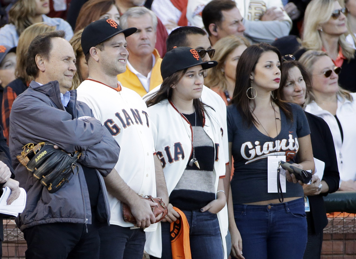 Billy Crystal watches a tribute to Robin Williams with Williams' family before Game 5 of baseball's World Series between the