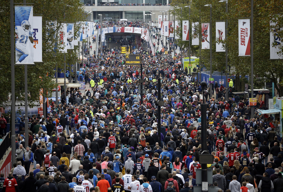 Fans arrive at Wembley Stadium before the NFL football game between the Atlanta Falcons and the Detroit Lions in London, Sund