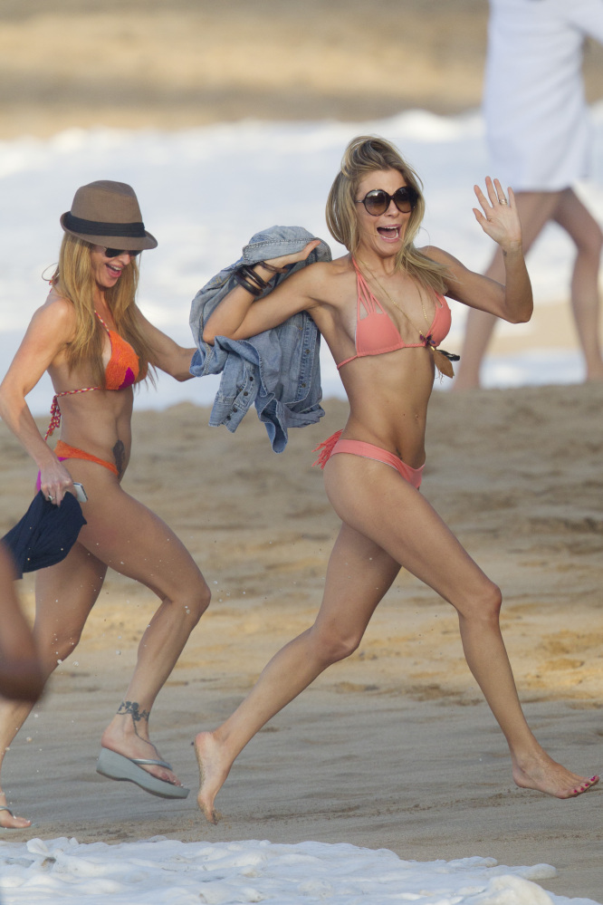 LeAnn Rimes gets playful, dodging the surf. 