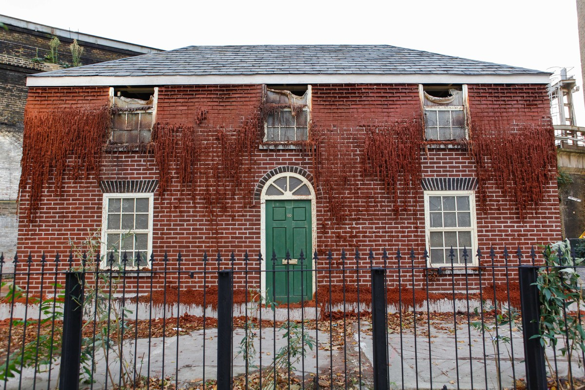 "<a href=""http://mergefestival.co.uk/"">Melting House</a> by <a href=""http://www.alexchinneck.com/"">Alex Chinneck</a>"