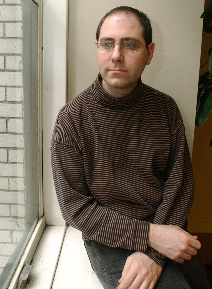 **FILE**   Jesse Friedman poses for a portrait in his lawyer's New York office in this Wednesday, Jan. 7, 2004 file photo. A