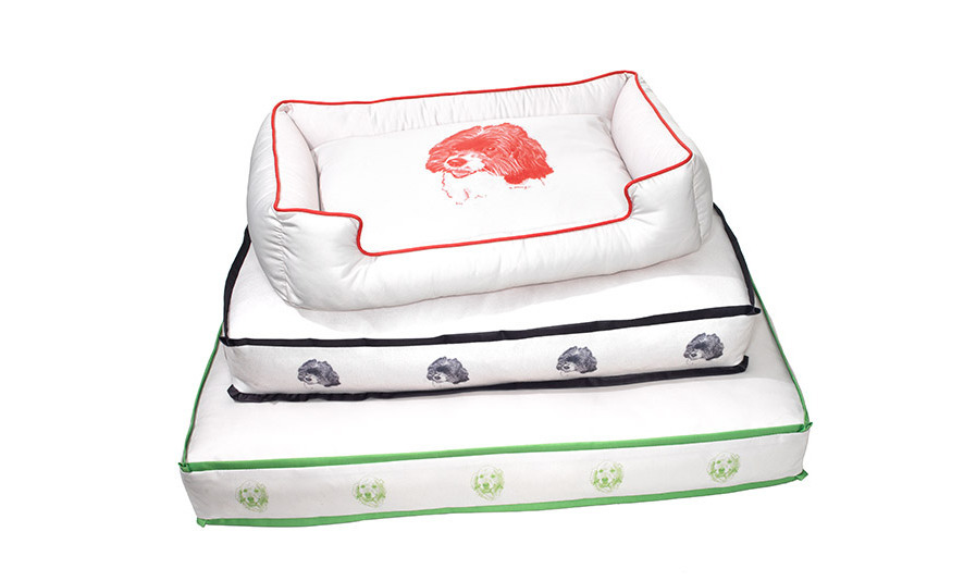 """<strong>Puppy Love</strong><br> """"These cushy dog beds, made with hypoallergenic fiberfill, have washable covers printed with"""