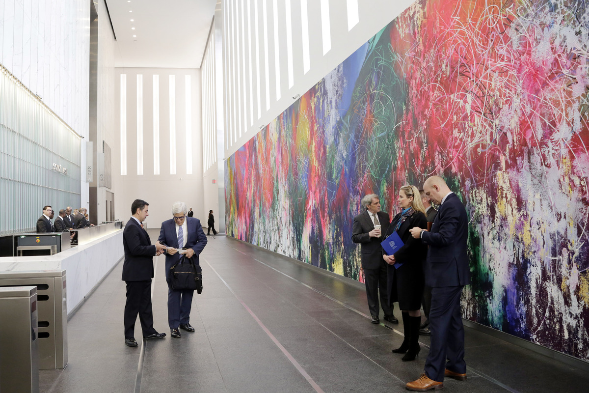 People gather in the lobby of One World Trade Center, Monday, Nov. 3, 2014 in New York.
