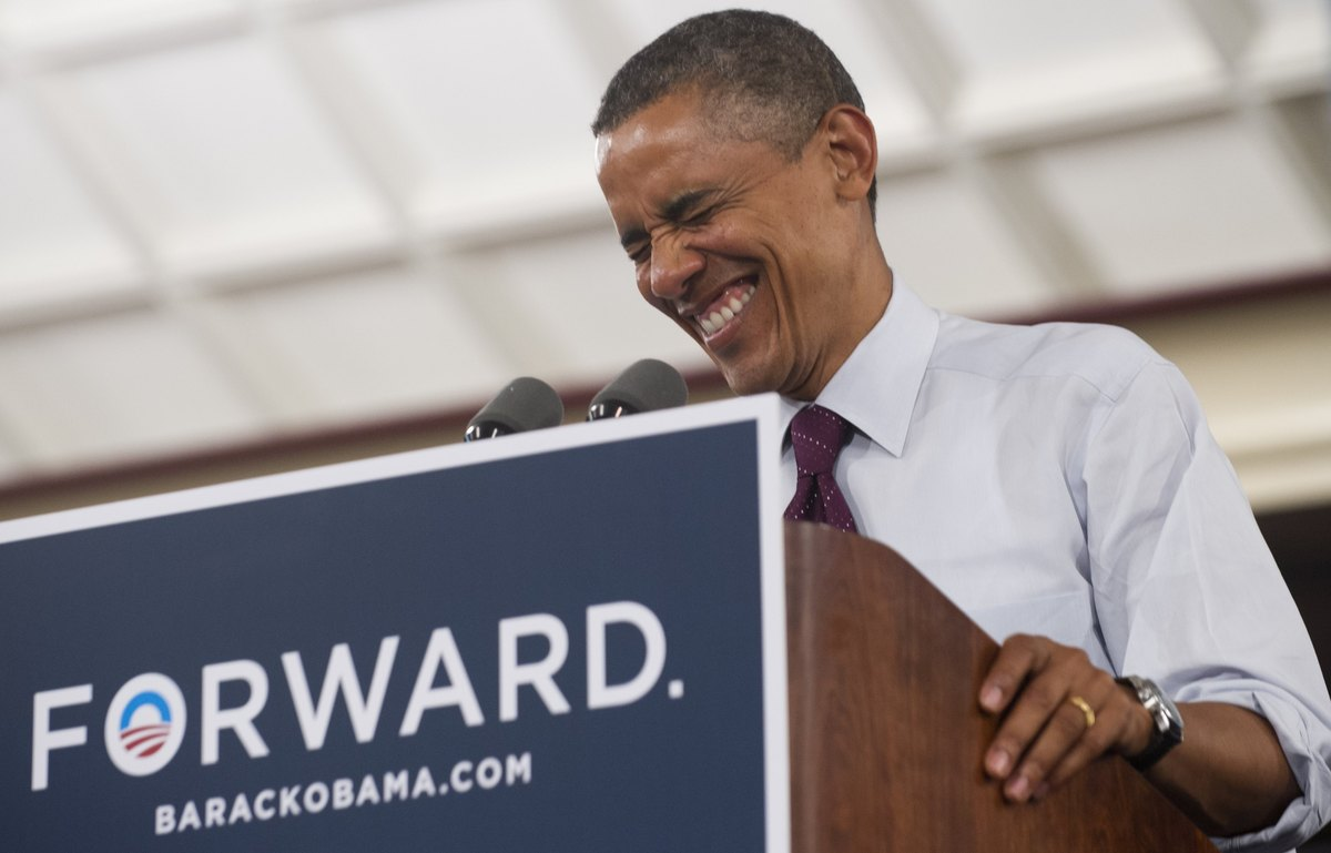 U.S. President Barack Obama laughs while speaking during a campaign event at the Cincinnati Music Hall in Cincinnati, Ohio, o