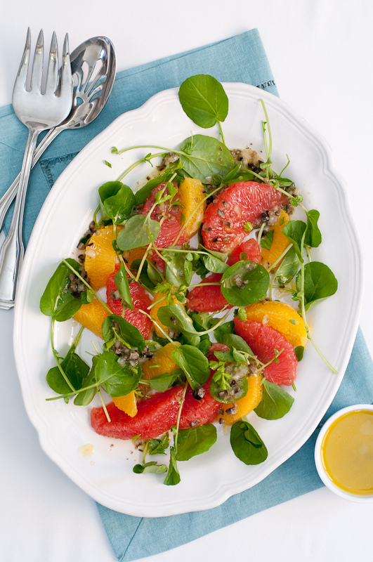 """<strong>Get the <a href=""""http://cafejohnsonia.com/2012/02/watercress-citrus-salad-with-olive-caper-vinaigrette.html"""" target="""""""