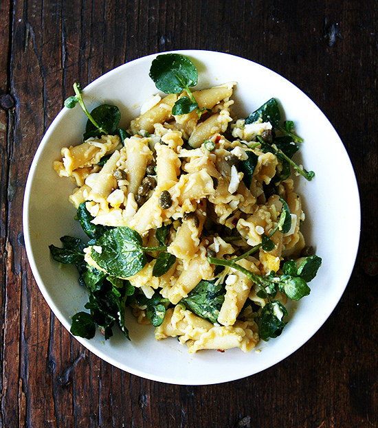 """<strong>Get the <a href=""""http://www.alexandracooks.com/2014/04/23/campanelle-with-hard-boiled-eggs-capers-watercress/"""" target"""