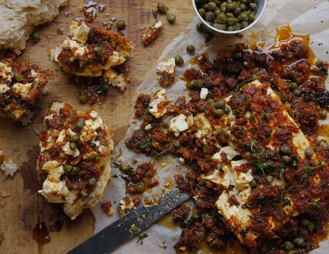 """<strong>Get the <a href=""""http://food52.com/recipes/25060-baked-feta-cheese-with-sun-dried-tomato-and-capers"""" target=""""_blank"""">"""