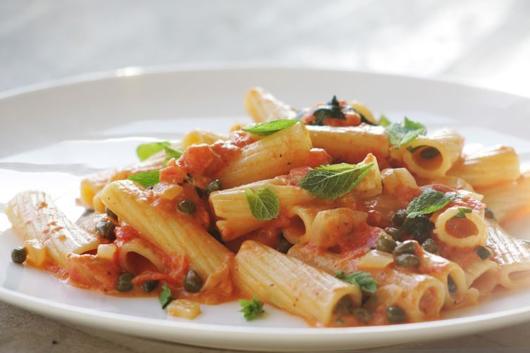 """<strong>Get the <a href=""""http://food52.com/recipes/24748-rigatoni-with-capers-and-mint"""" target=""""_blank"""">Rigatoni with Capers"""
